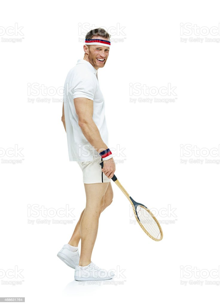 Smiling male tennis player looking at camera stock photo