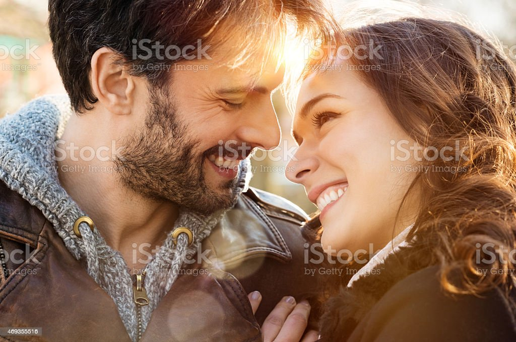 Smiling man and woman in loving stare with each other stock photo