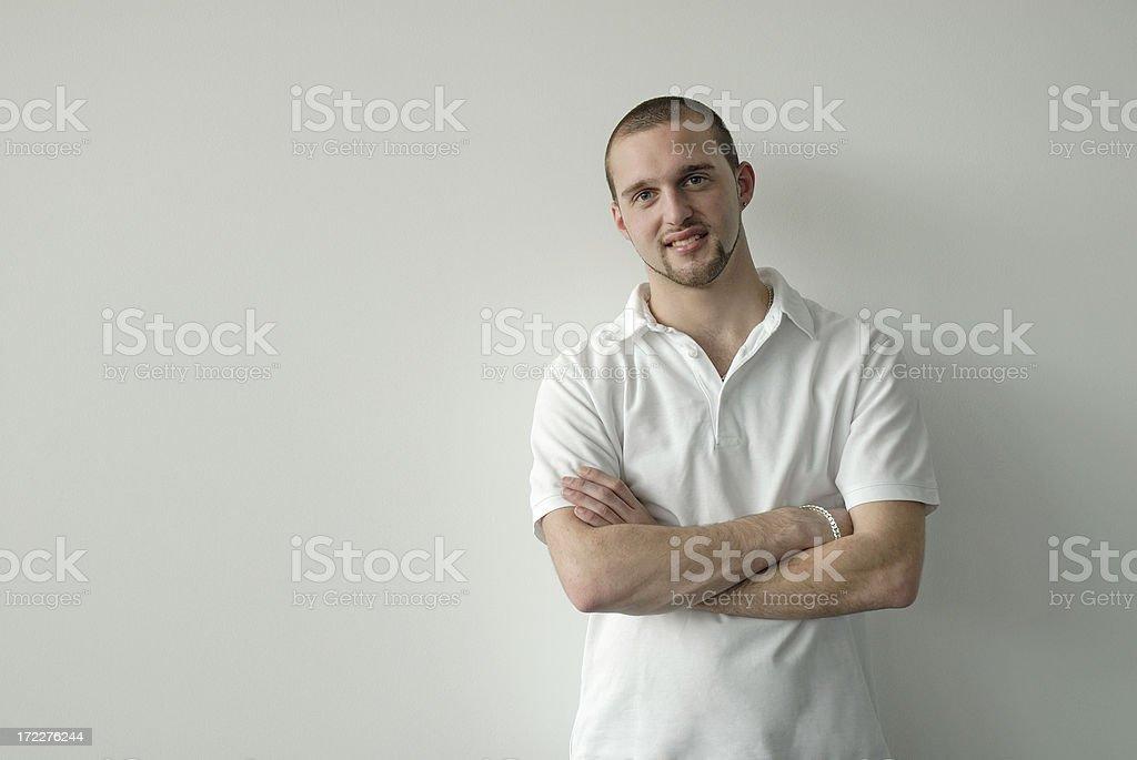 smiling man at wall royalty-free stock photo