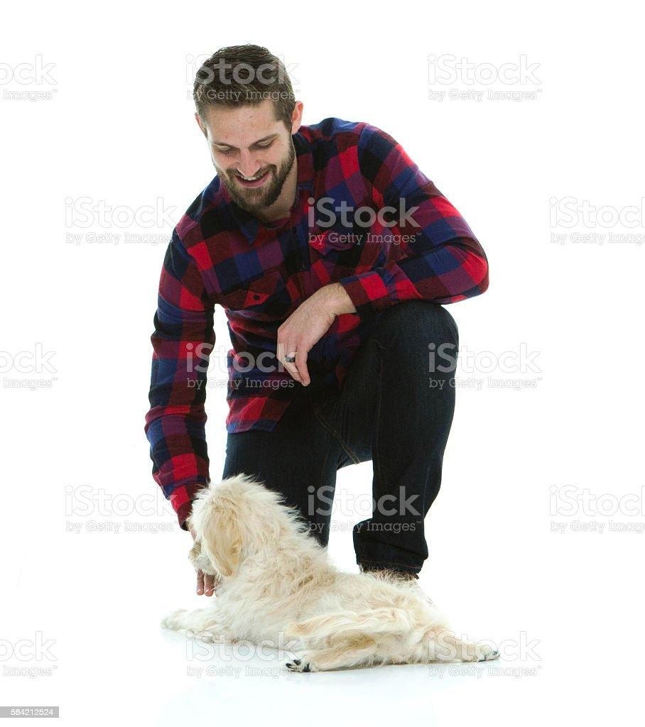 Smiling man bonding with his dog stock photo