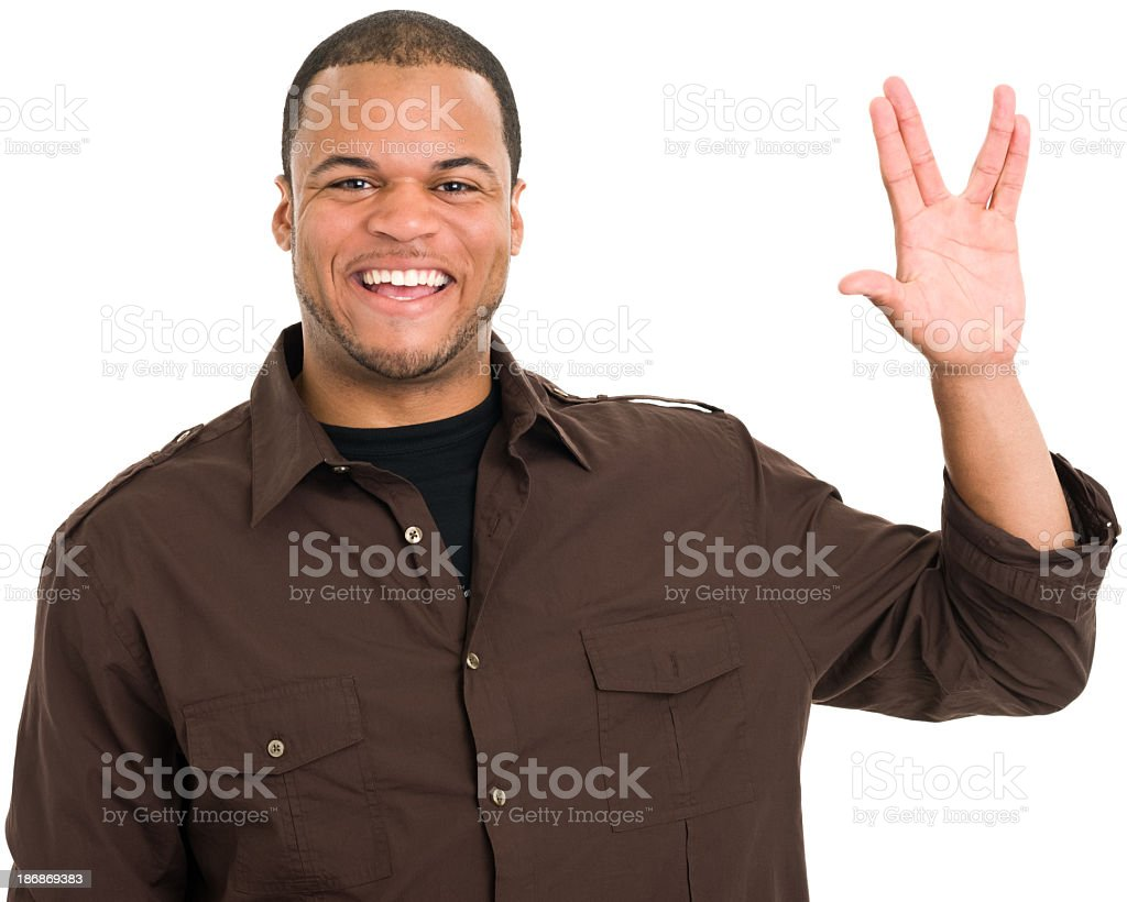 Smiling Man Gives Vulcan Salute stock photo