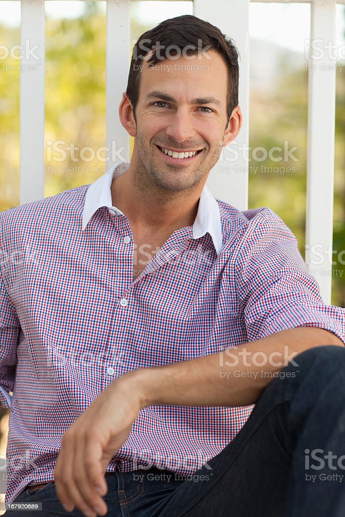 Smiling man having cup of coffee outdoors royalty-free stock photo