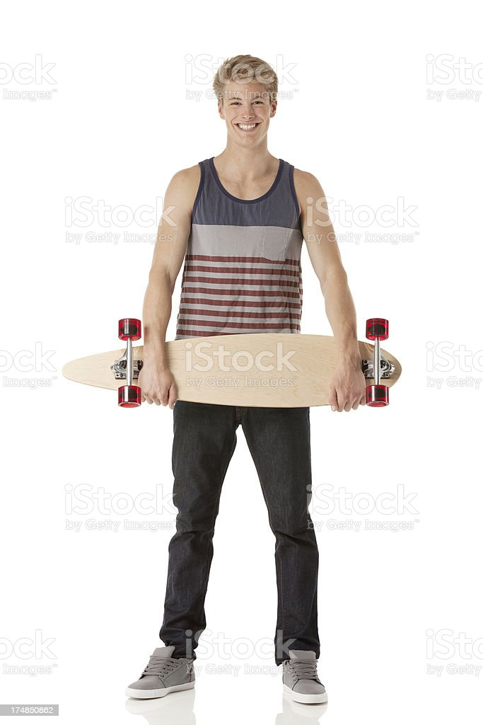 Smiling man holding a long board royalty-free stock photo