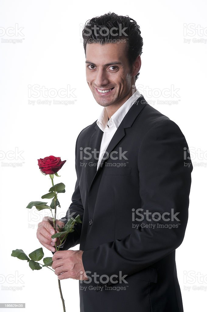 smiling man holding a single red rose stock photo
