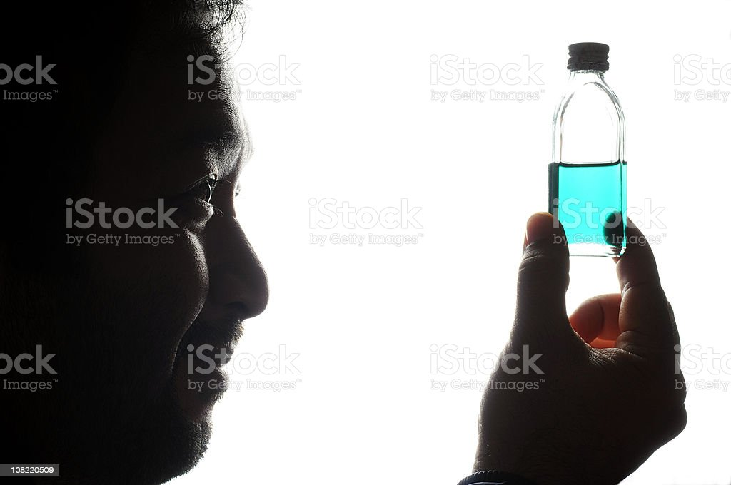 Smiling Man Holding bottle of Blue Liquid royalty-free stock photo