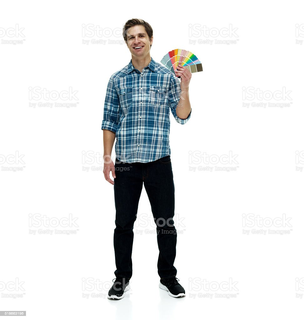 Smiling man holding color swatch stock photo