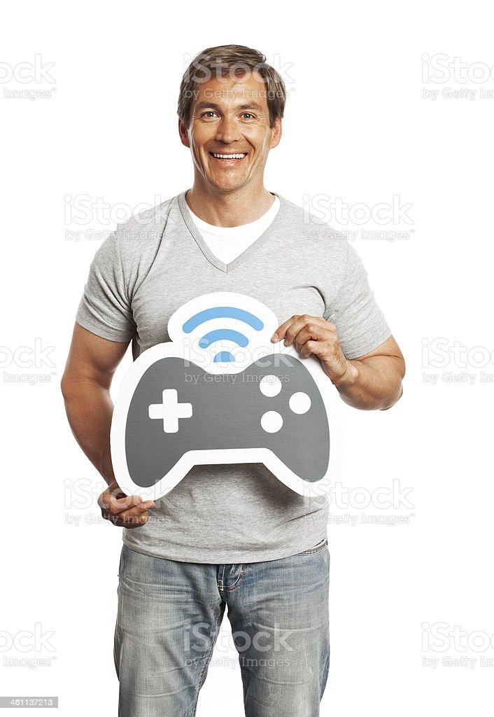 Smiling man holding gamepad sign isolated on white background. royalty-free stock photo