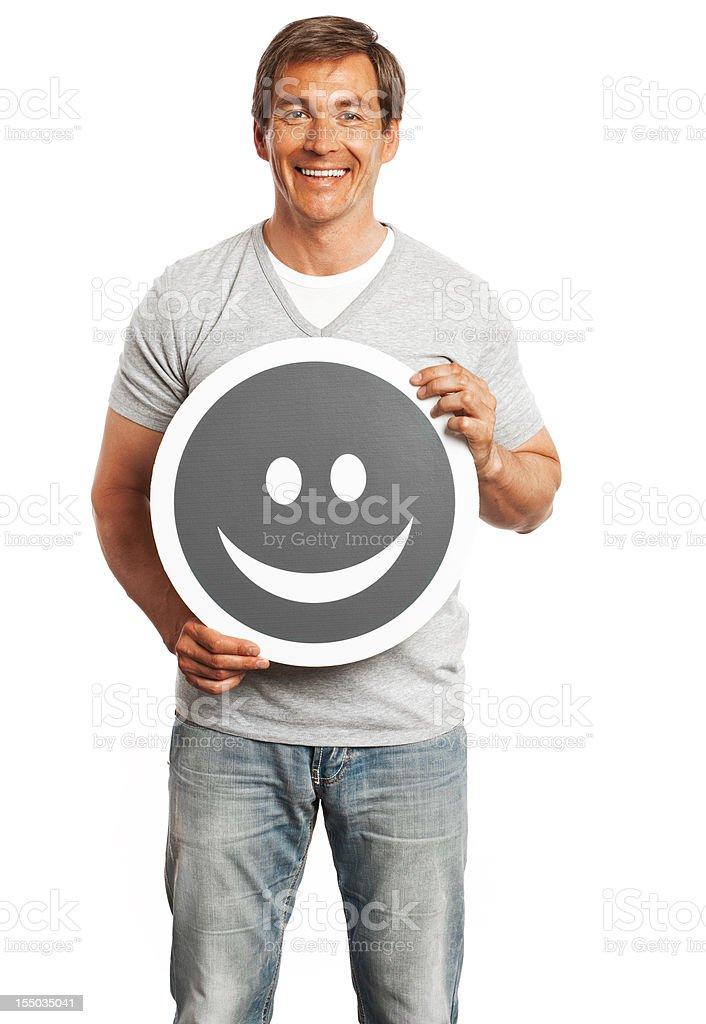 Smiling man holding happy smile sign isolated on white background. royalty-free stock photo