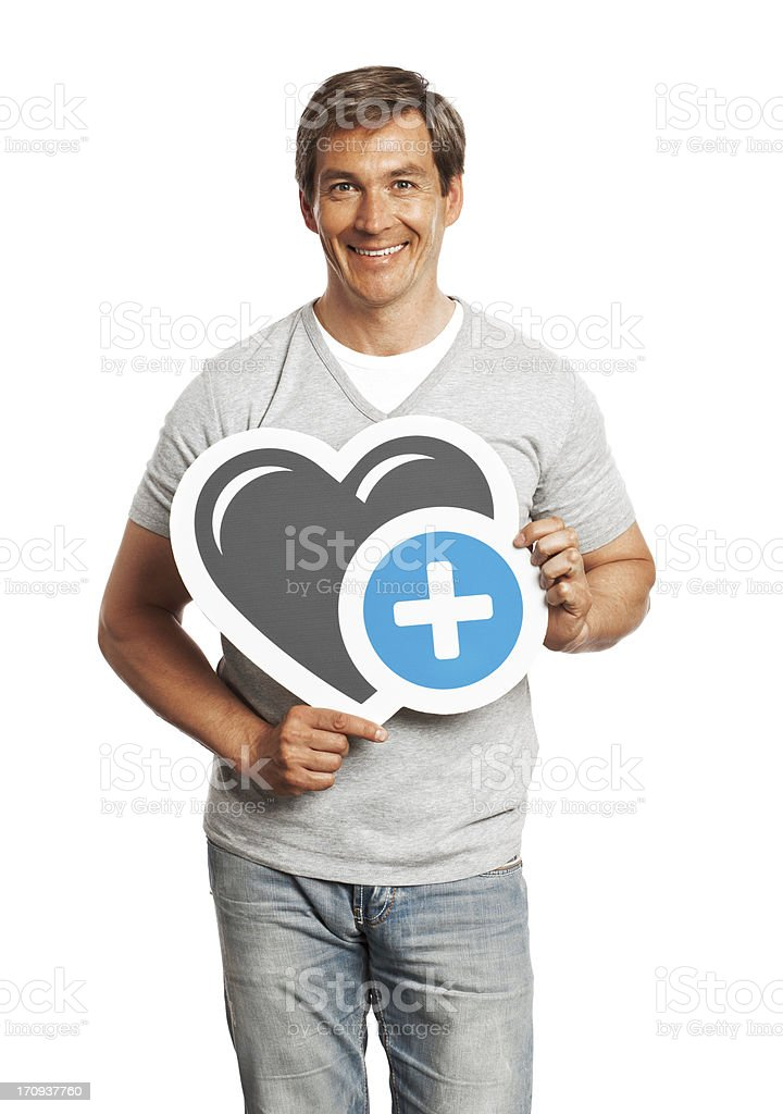 Smiling man holding heart sign isolated on white background. stock photo