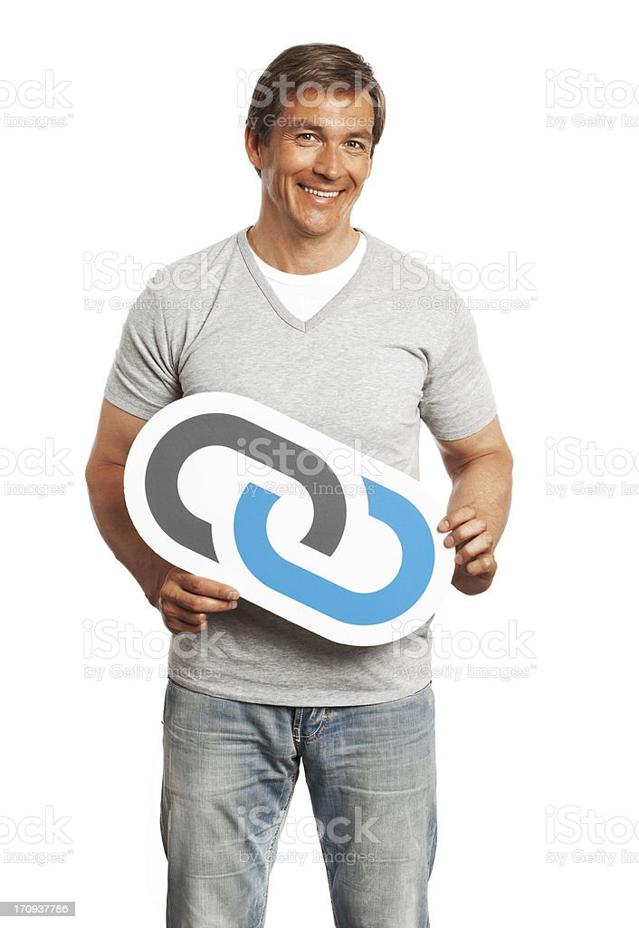 Smiling man holding link sign isolated on white background. royalty-free stock photo