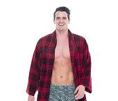 Smiling man in bathrobe and looking at camera