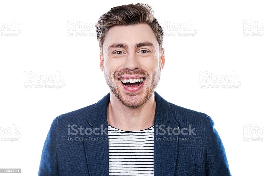 Smiling man in blue jacket and white striped shirt stock photo