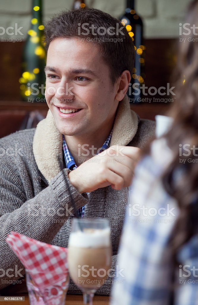 Smiling man in cafe stock photo