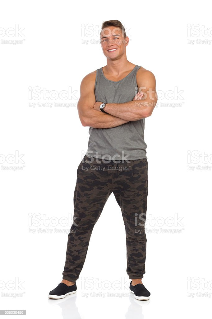 Smiling Man In Gray Tank Top Full Length Isolated stock photo