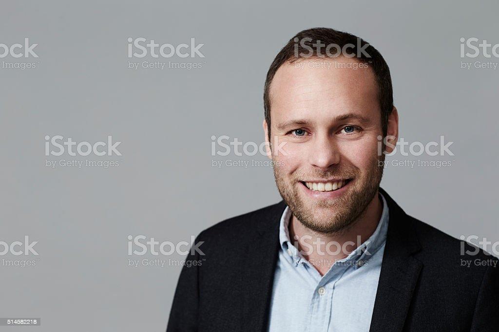 Smiling man in jacket, portrait stock photo