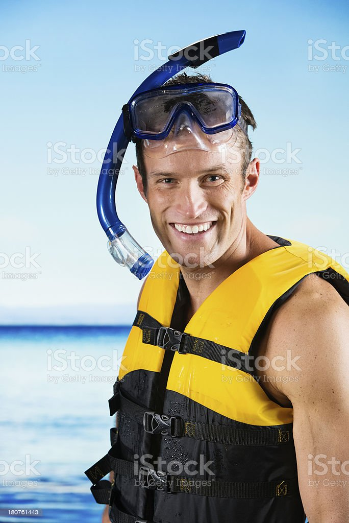 Smiling man in snorkeling gear royalty-free stock photo