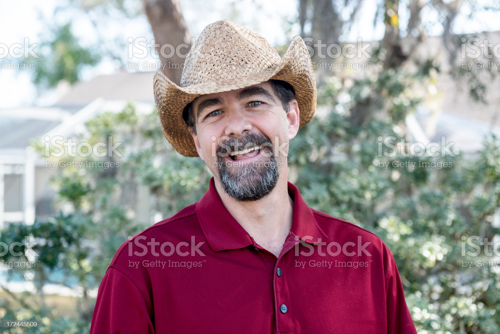 Smiling Man in Straw Hat royalty-free stock photo