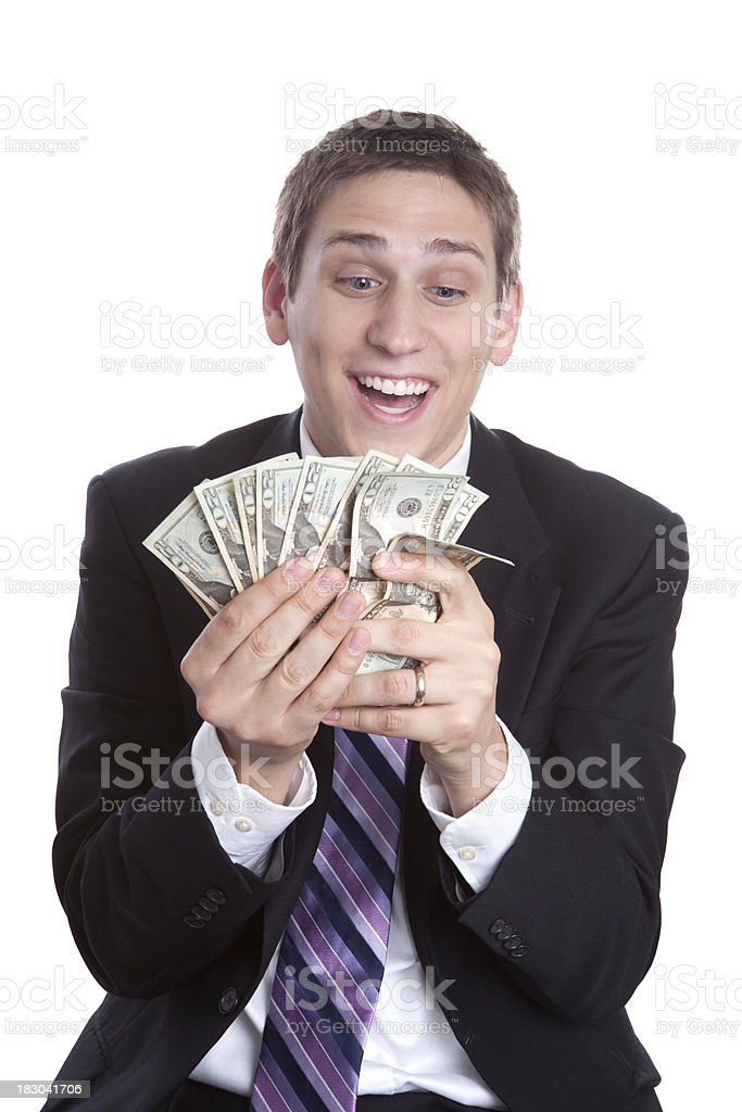 Smiling Man in Suit and Tie Holding Money royalty-free stock photo