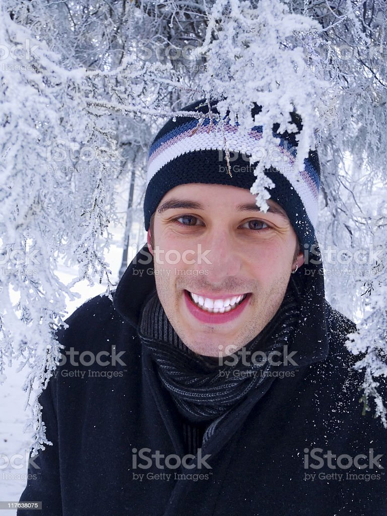 Smiling man in winter park royalty-free stock photo