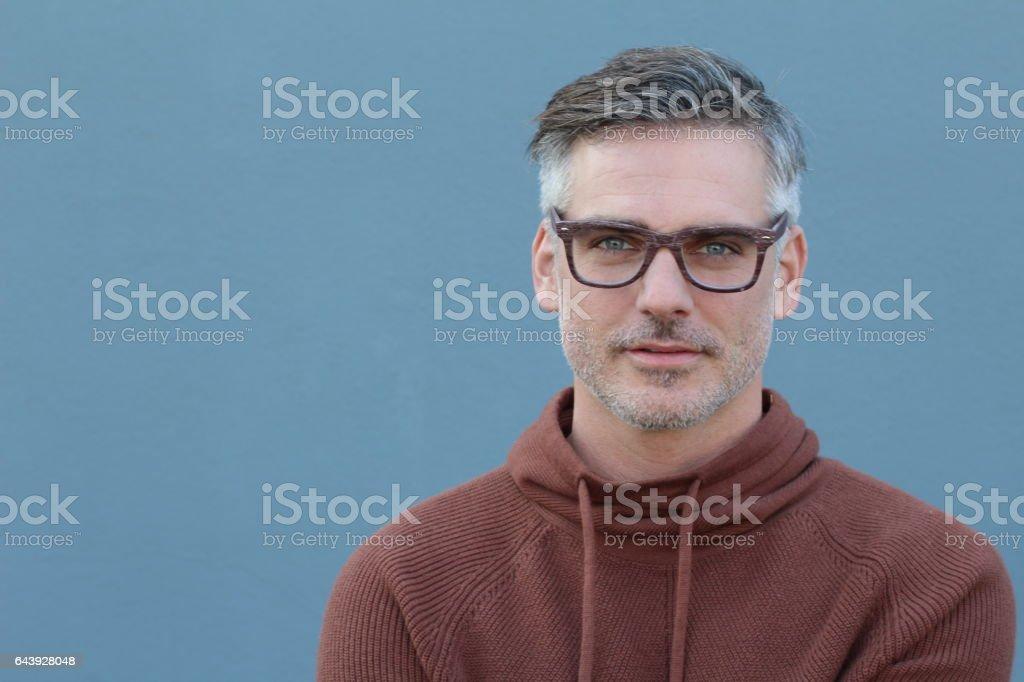 Smiling man isolated on blue background stock photo
