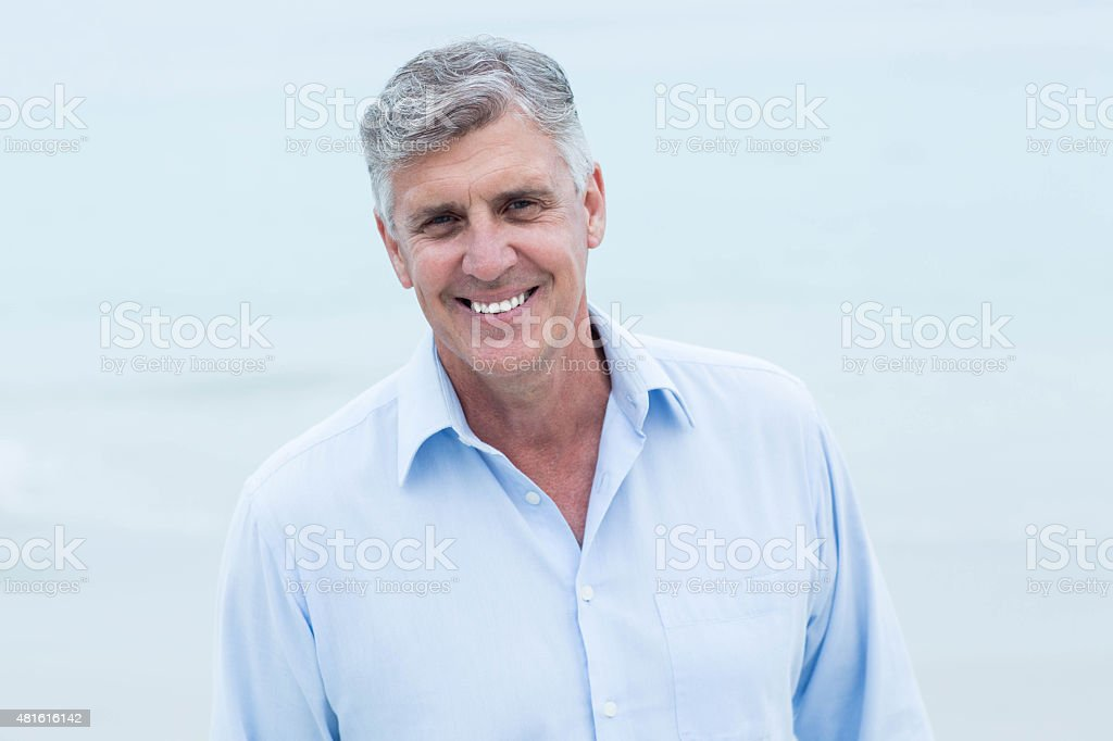 Smiling man looking at camera stock photo
