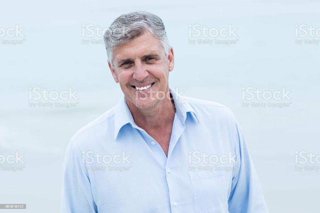 Smiling man looking at camera stock photo