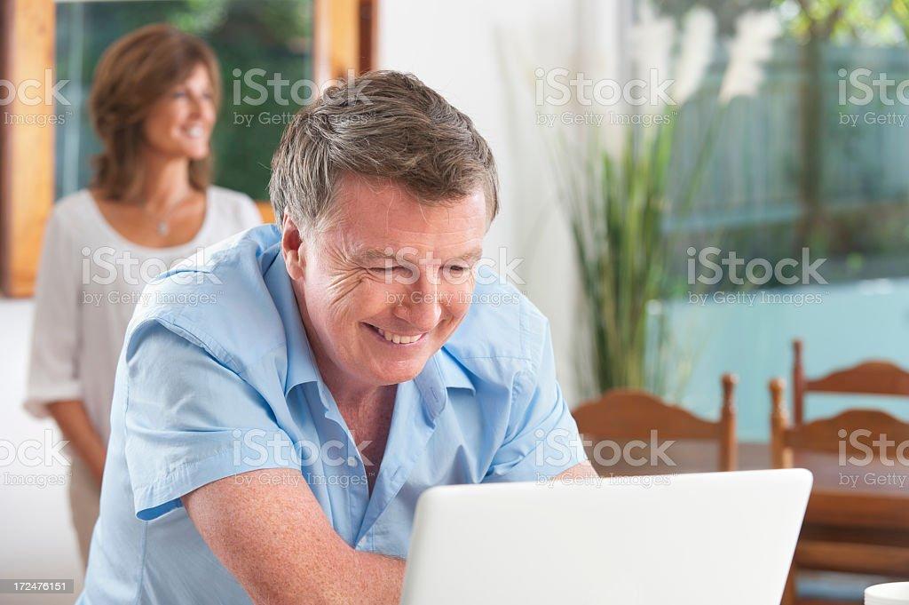 Smiling man looking at computer royalty-free stock photo