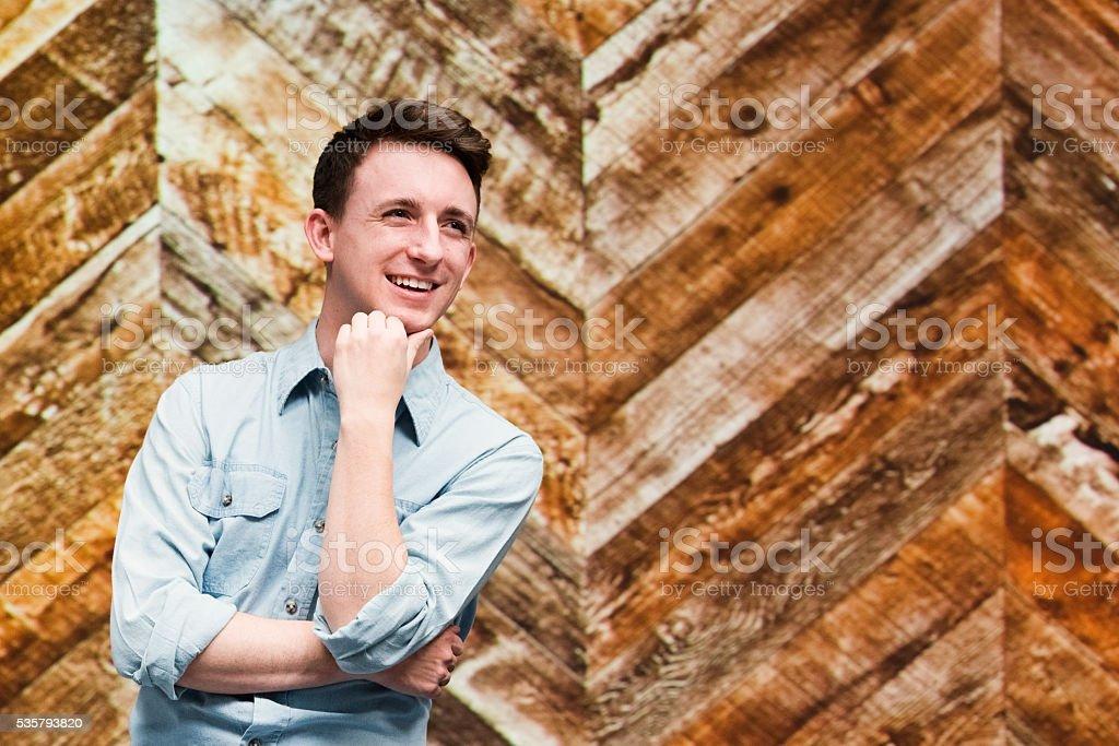 Smiling man looking away stock photo