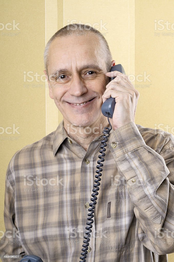 Smiling Man on Phone stock photo