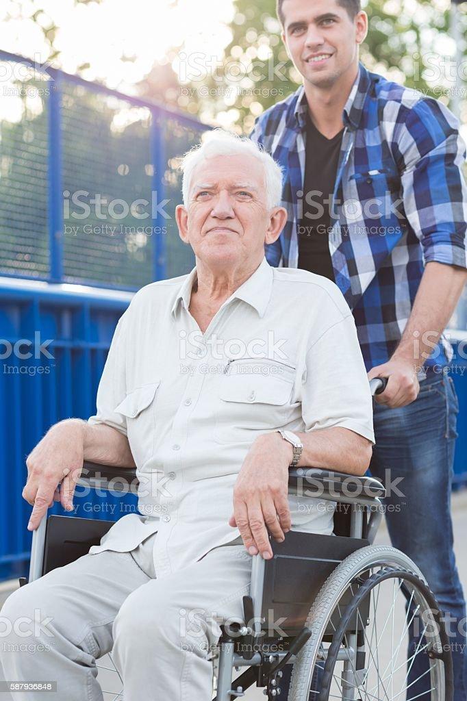 Smiling man on wheelchair stock photo