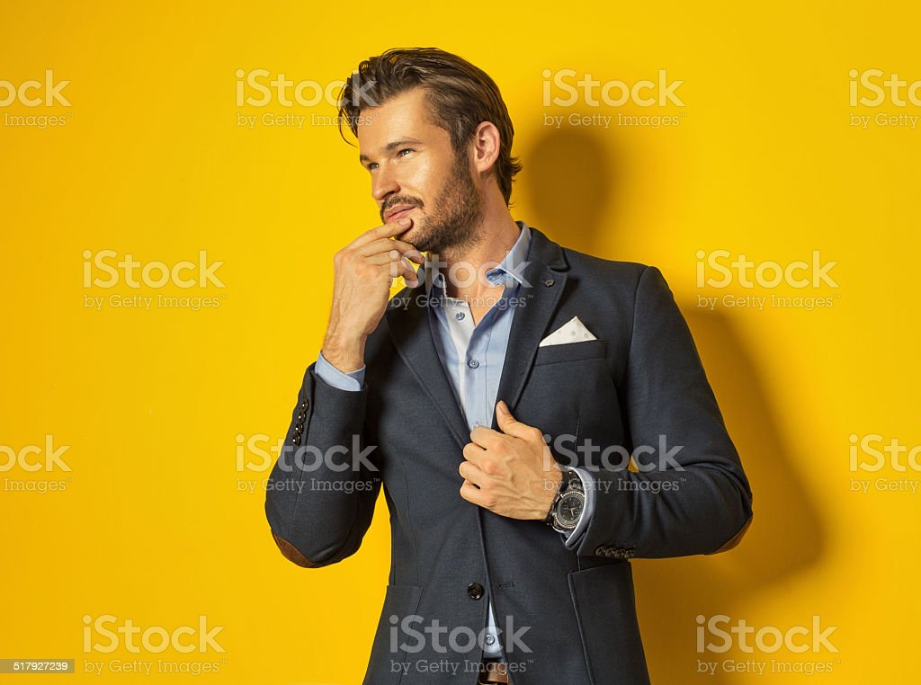 Smiling man on yellow background stock photo
