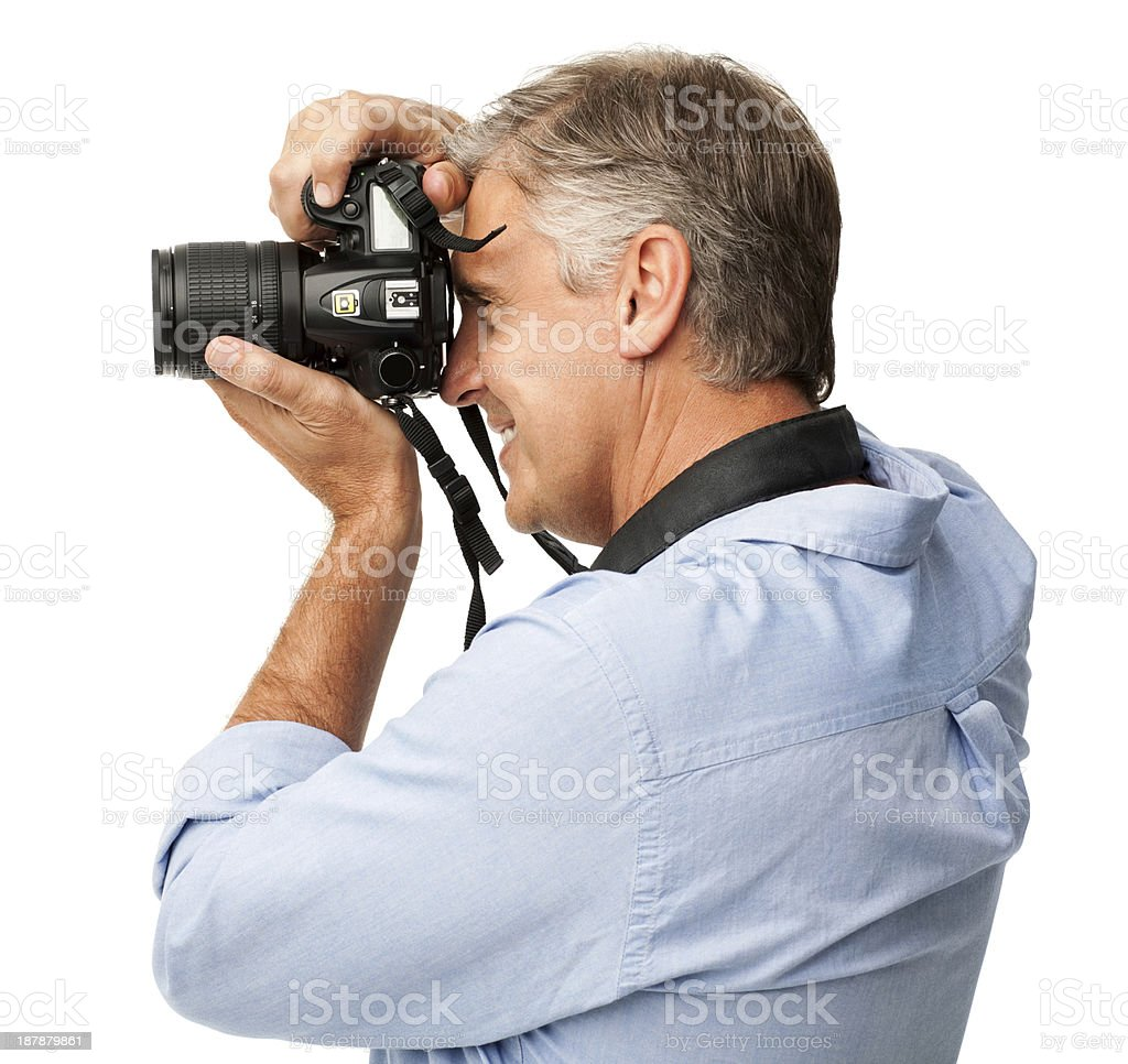 Smiling Man Photographing Through SLR Camera stock photo