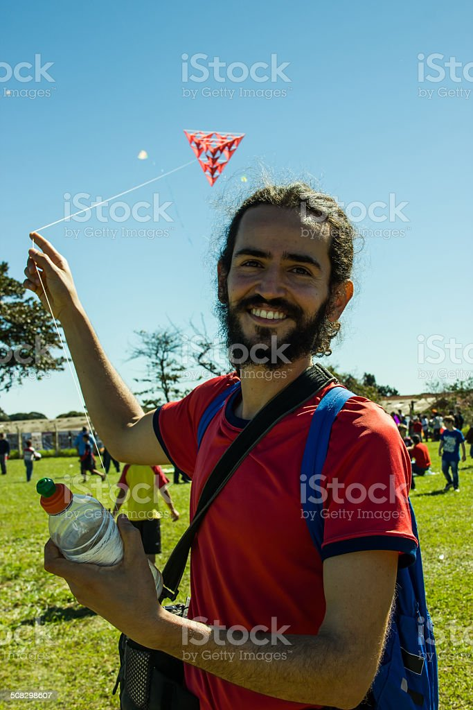 Smiling Man Playing with a Kite stock photo