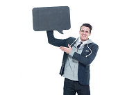 Smiling man presenting with speech bubble