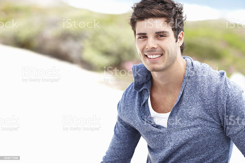 Smiling man relaxing outdoors royalty-free stock photo