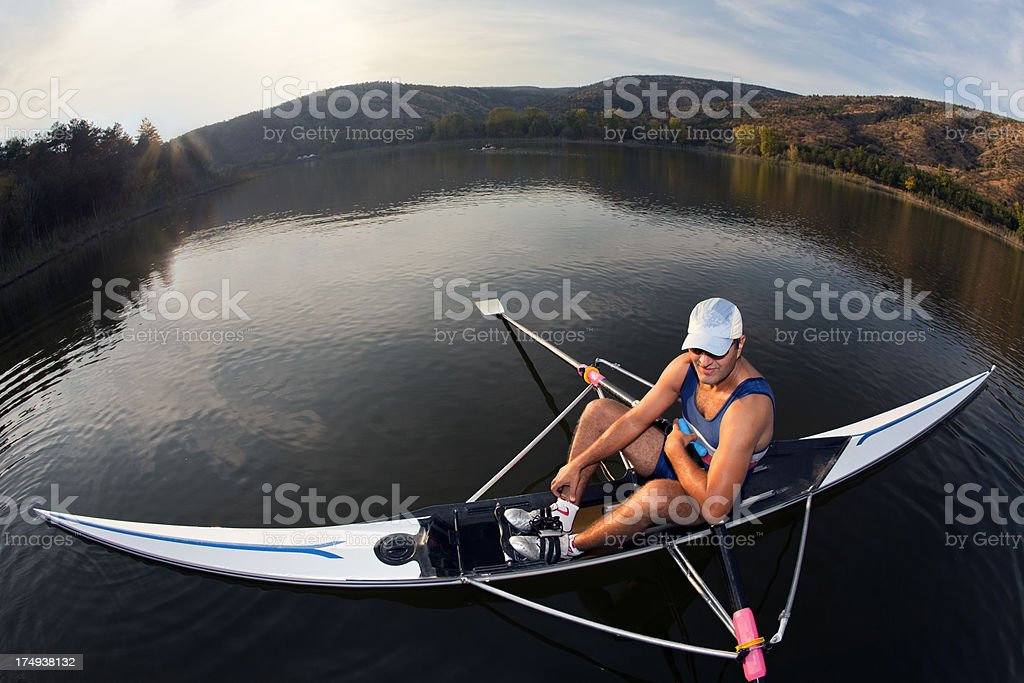 Smiling man resting on the boat with fisheye stock photo