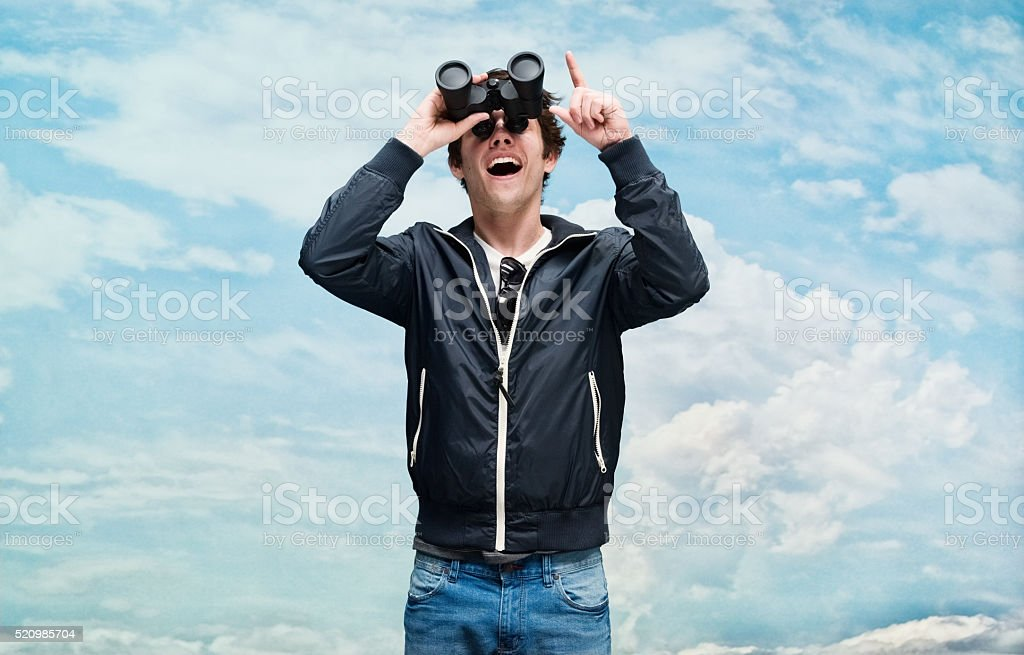 Smiling man searching and pointing stock photo