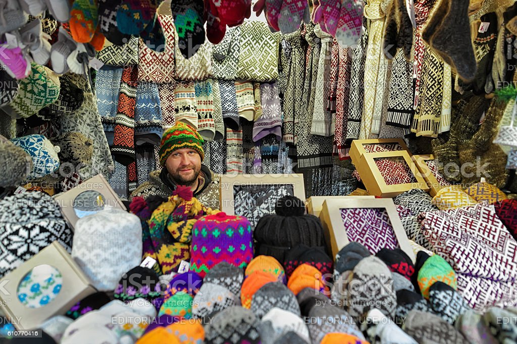 Smiling Man selling warm clothes at the Riga Christmas Market stock photo