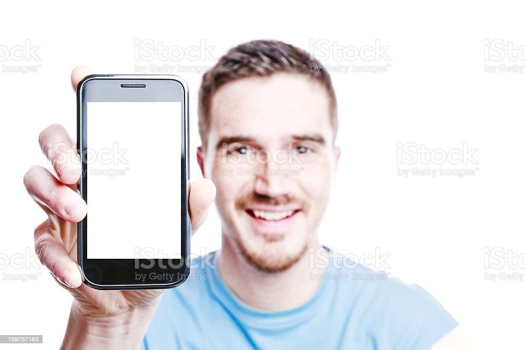 Smiling Man Shows a Phone stock photo