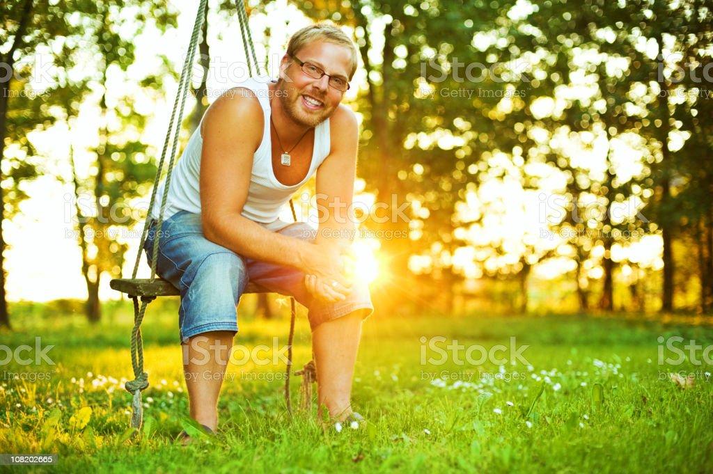 smiling man sitting in sunshine royalty-free stock photo