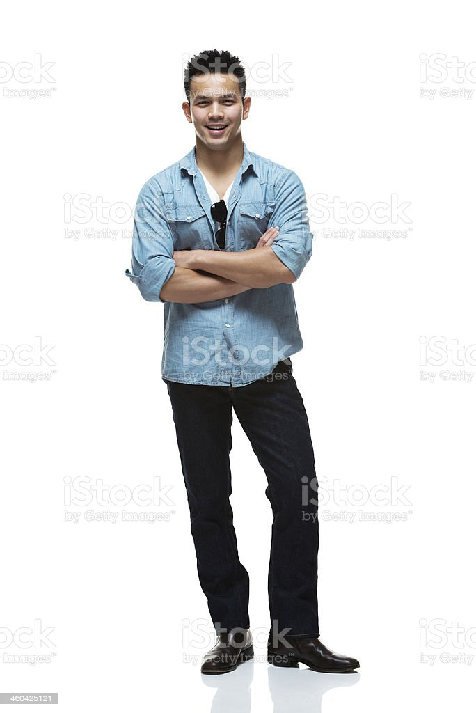 Smiling man standing with arms crossed royalty-free stock photo