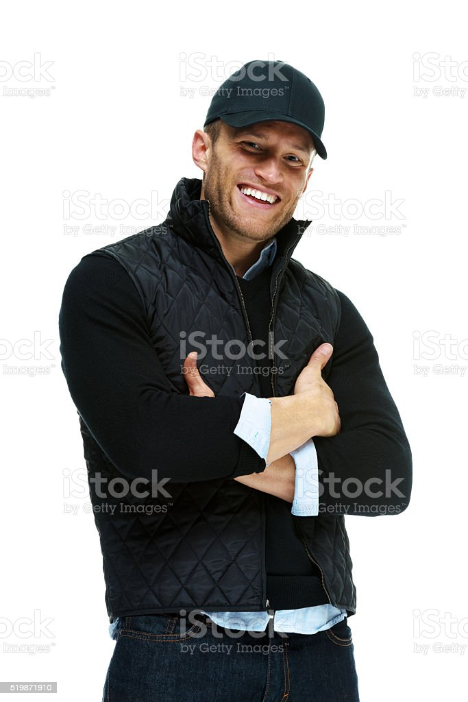 Smiling man standing with arms crossed stock photo
