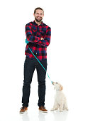Smiling man standing with dog