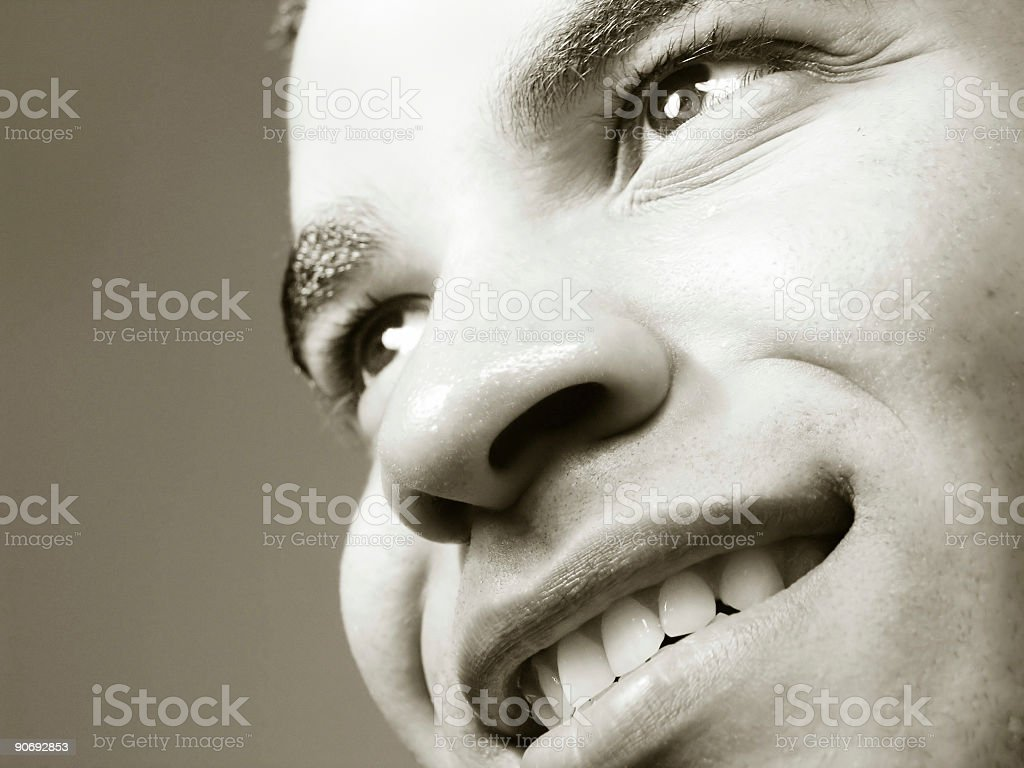 Smiling man staring into distance royalty-free stock photo