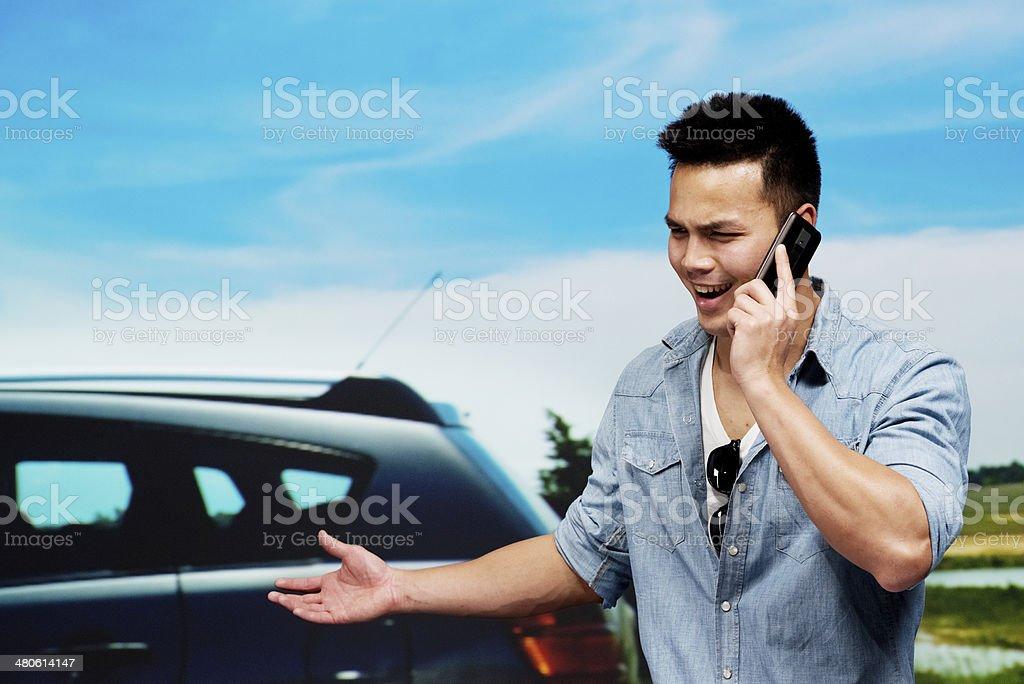 Smiling man talking on mobile phone stock photo