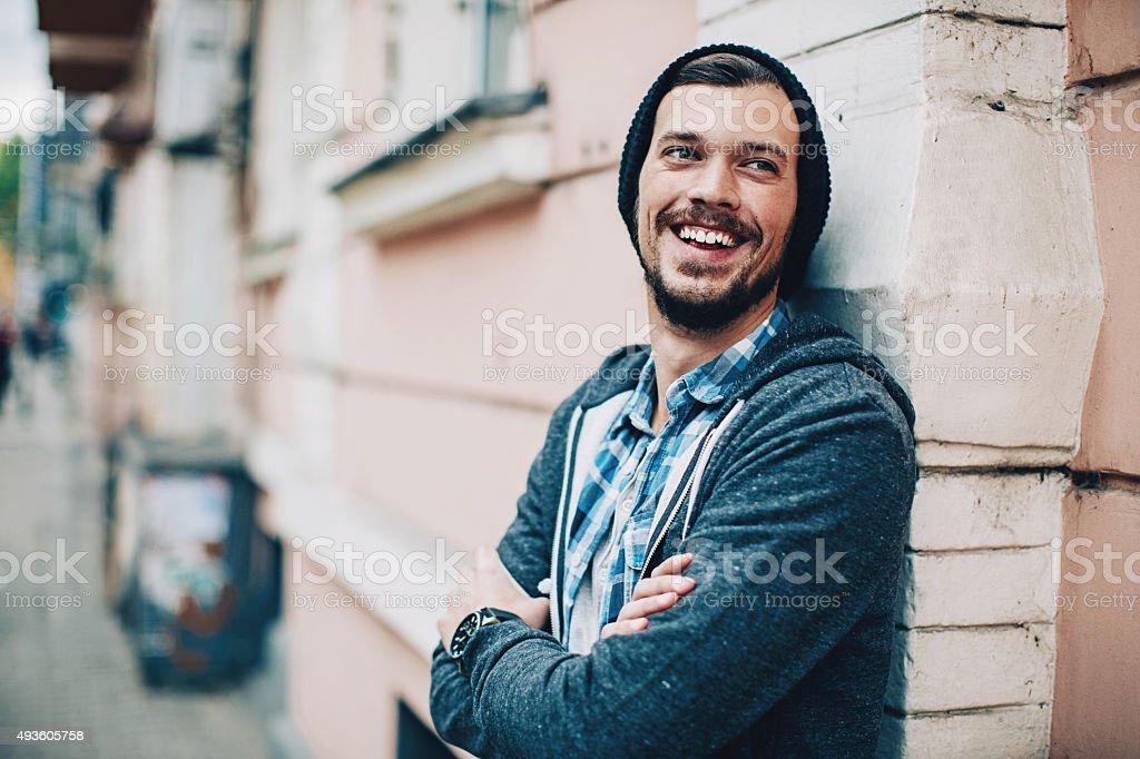 Smiling man urban scene stock photo