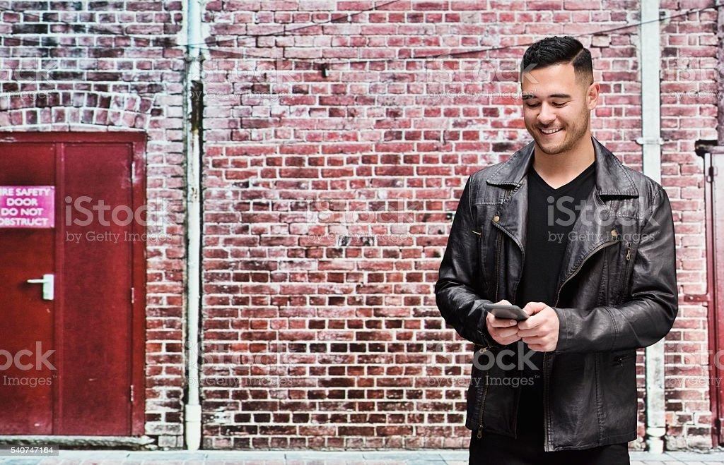 Smiling man using phone stock photo