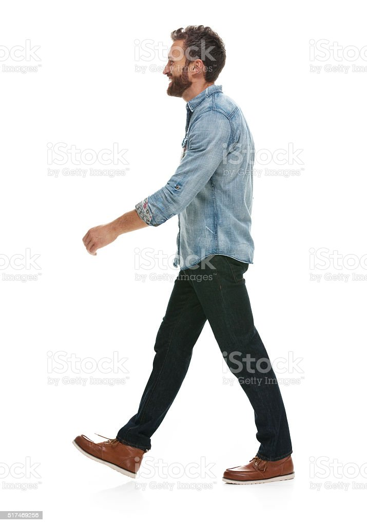 Smiling man walking and looking away stock photo