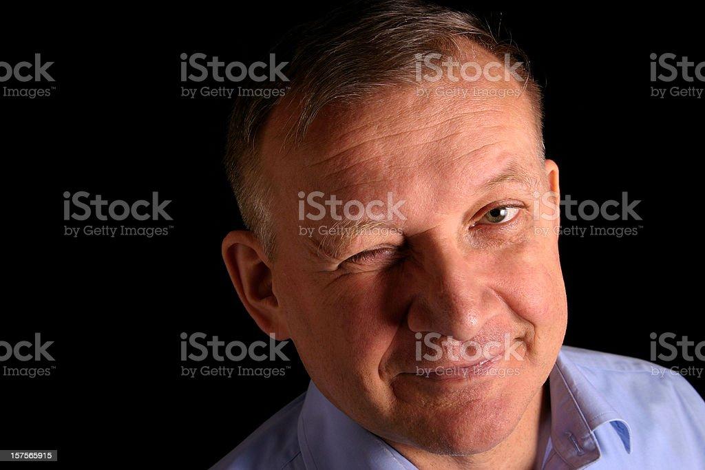 Smiling man winking stock photo
