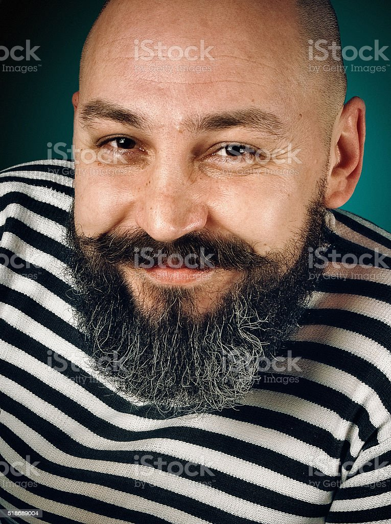 smiling man with a beard stock photo
